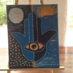 This is Sun and Moon Hamsa Art