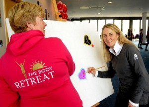 Charity boot camp day at Dorney Lake Julie Brealey (l) and artist Steffi Goddard (r) painting hearts on the LoveHug